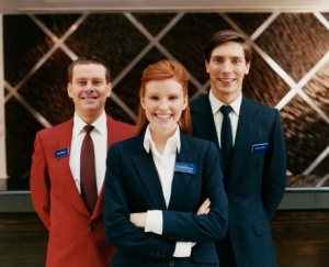 Portrait of Three Smartly Dressed Male and Female Hotel Staff