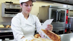 Culinary arts major Stephanie Olsen reads an order in the JSB Cafeteria at City College on Tuesday, Nov. 6, in Santa Barbara (Calif.) The JSB is an entirely student run cafeteria.