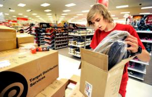 1107TARGET.jpg Riley Strick pulls boots from a packing box while stocking the shoe section of Target in Broomfield, Colorado November 7, 2011. CAMERA/Mark Leffingwell